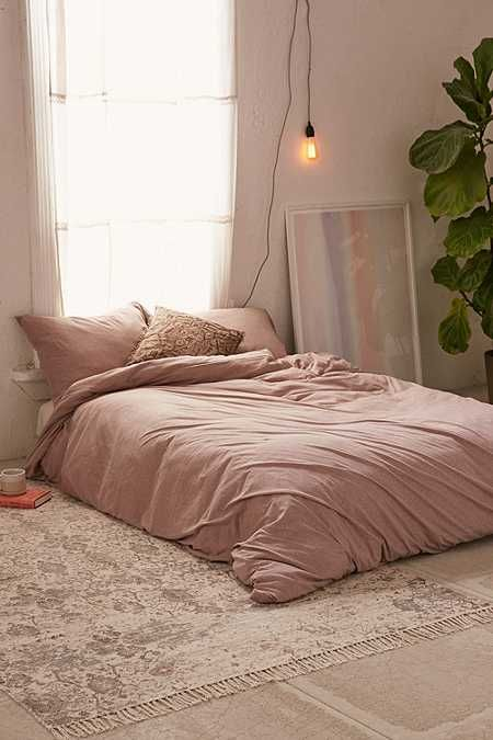 pale pink bedding treatment Boho rug with subtle patterns and tassels