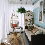 Screened Porch With White Sheer Curtains Vintage Runner Rattan Swing Black Woven Sofa With White Cushion Round Top Bamboo Table Ceiling Fan