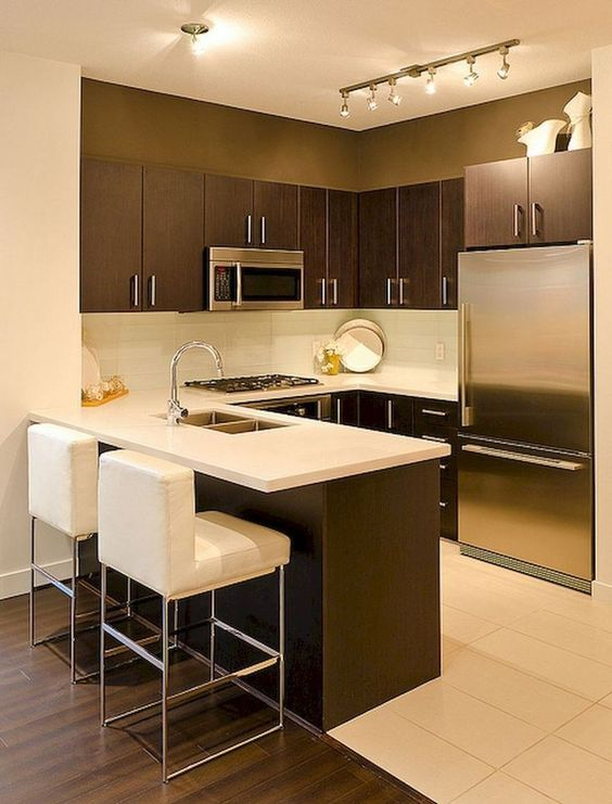 small kitchen design in modern style modern bar stools in white with stainless steel frame dark wood kitchen cabinetry white backsplash white countertop stainless steel appliances