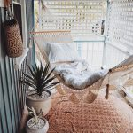 Spring Porch Refreshment Idea With Boho Swing And Round Shaped Boho Rug Plants With Pottery Planters White Screen