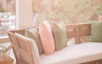 spring refresh with soft and natural tones soft colored throw pillows woven sofa with white cushion b
