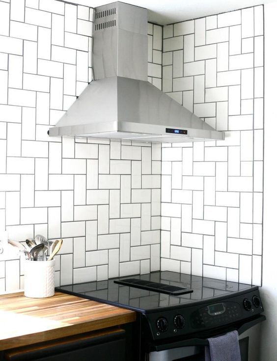 straight herringbone patterned subway tile installation for kitchen