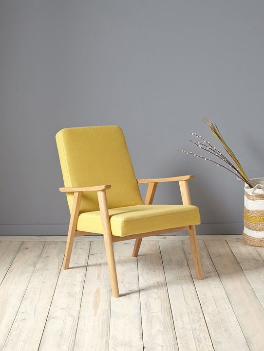 sunny yellow chair with light wood frame whitewashed wood plank floors blue walls
