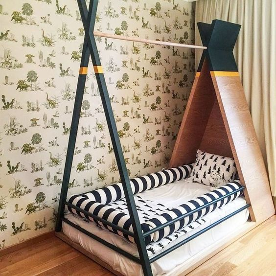 tipi bed frame with headboard and sideboard white mattreess with fluffy pillow around it