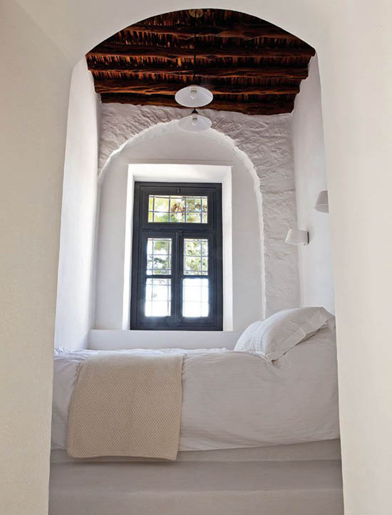 white bedding treatment cream blanket arched window with black trims higher wood ceilings