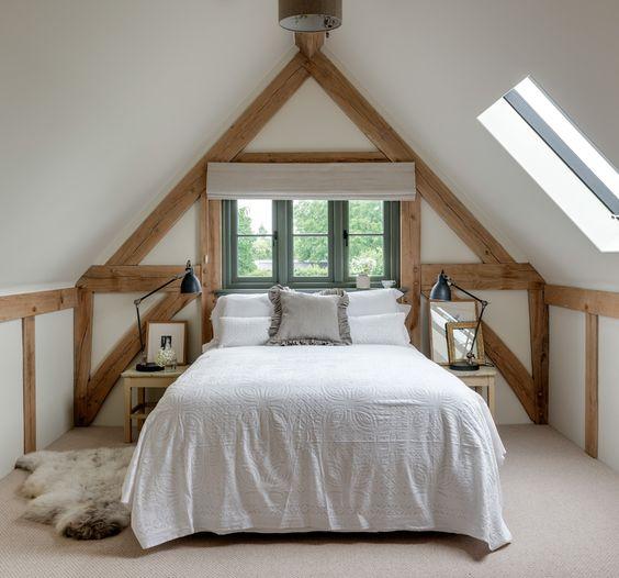 white bedding treatment gray shag rug exposed wood beams white walls ceilings light wood floors