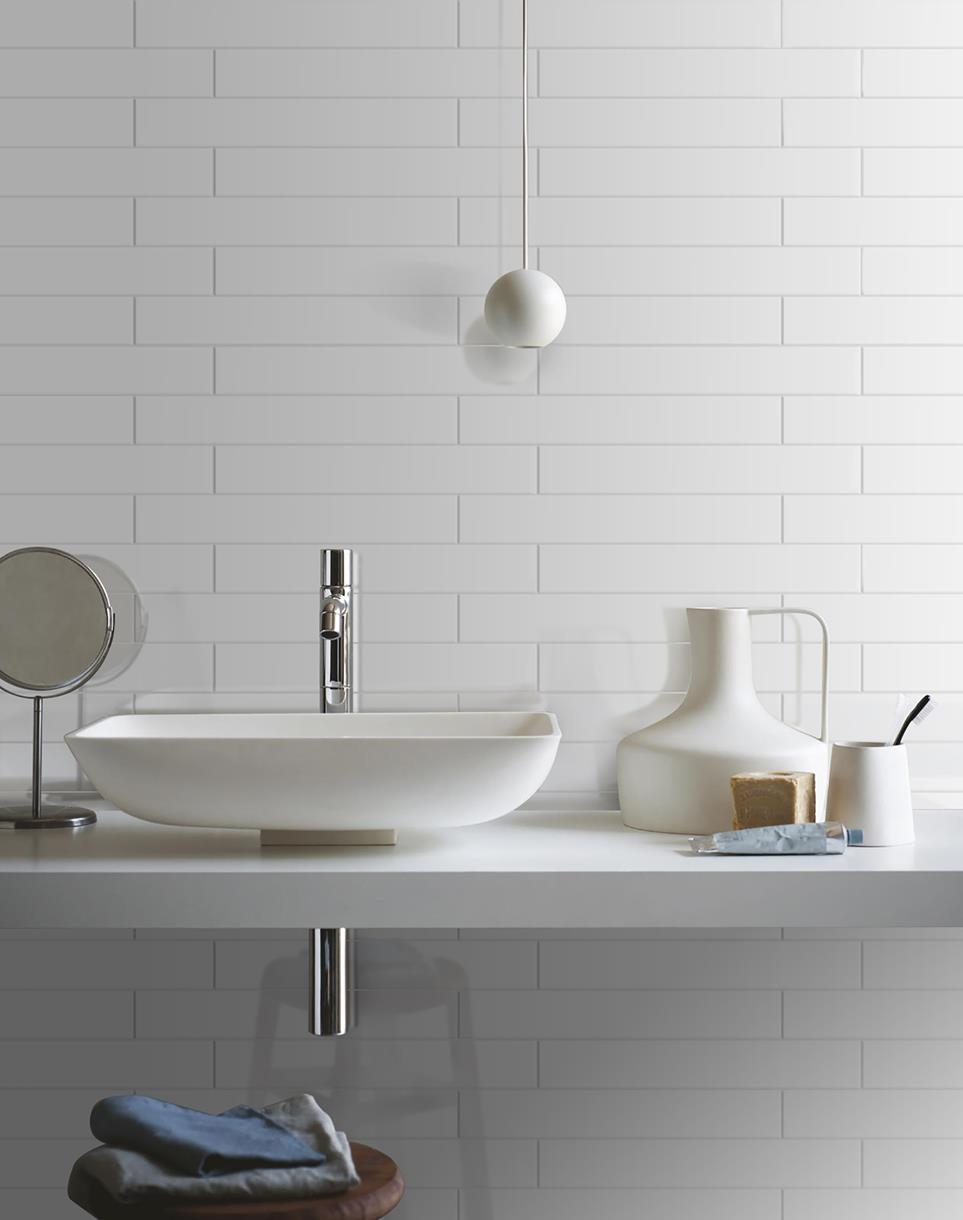 white subway tile installation with thinner grouts for classic elegant and subtle look