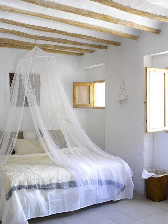 white walls sheer canopy curtains in white exposed wood beams white tile floors