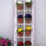 Whitewashed Window Trims As The Media For Potted Flowers