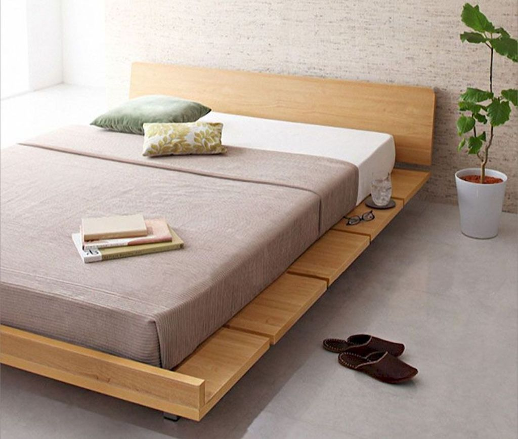 zen feel minimalist bedroom idea minimalist wood bed frame with headboard white potted houseplant concrete floors