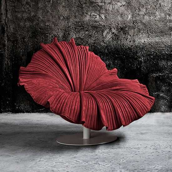 Hibiscus flower inspired lounge chair in bold red color with metal base