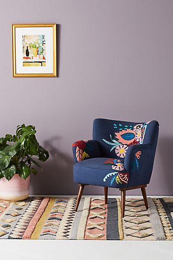 accent chair in midcentury modern style highlighted with navy blue color and colorful blooms