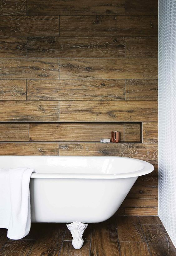 classic style bathroom design wood tiled walls with recessed shelf clawfoot bathtub in white