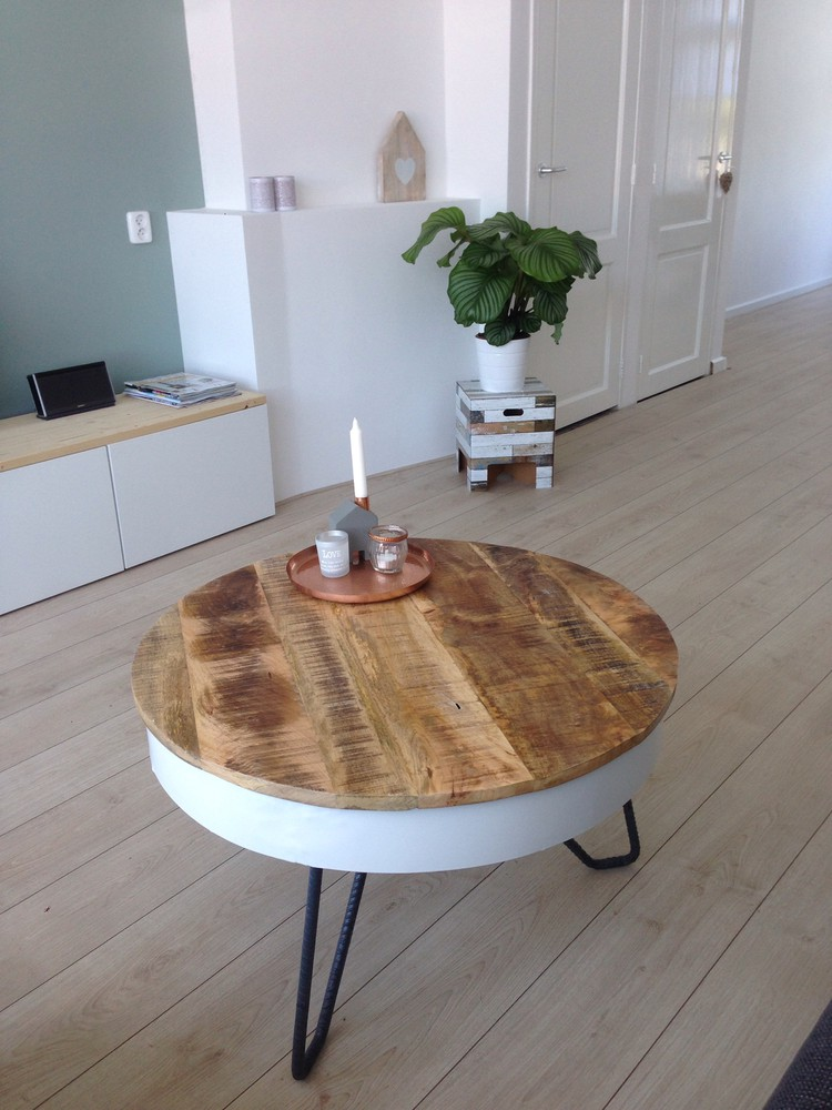 coffee table with round shaped hardwood top and hairpin legs