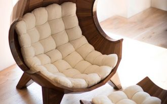 egg lounge chair with hard wood frame and tufted squishy cushion in white
