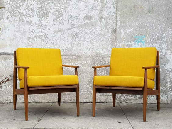 midcentury modern accent chairs with mustard upholstery and wood frames