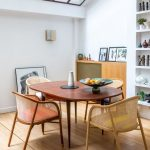 Midcentury Modern Dining Furniture Consisting Of Light And Graphic Dining Chairs Curved Edge Dining Table