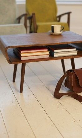 midcentury modern vintage coffee table in dark wood color