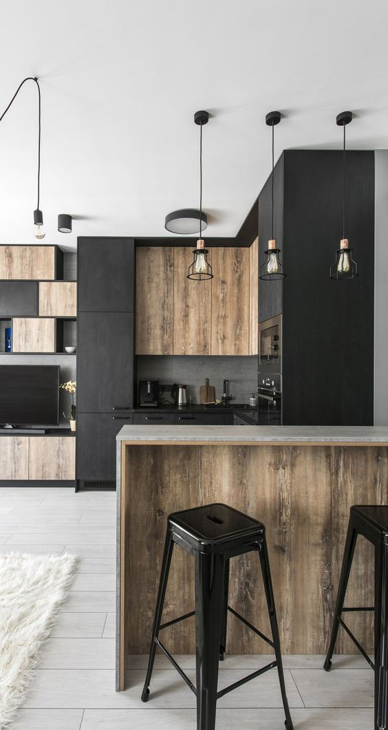 modern industrial kitchen design black matte cabinetry wooden cabinetry wooden bar tables black plastic bar stools white tile floors industrial pendants clean white ceilings