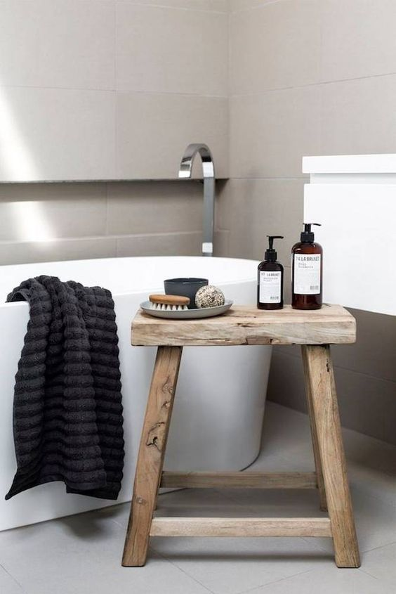 modern minimalist bathroom idea modern white bathtub milky wood stool ornate black linen stainless steel stand faucet