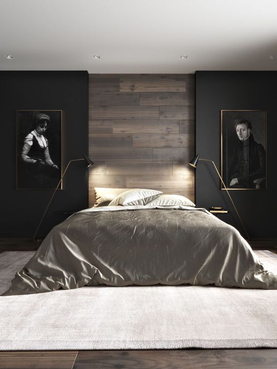 modern minimalist bedroom black finish walls with a central wood panel platform bed frame with gloss silver bed linens and comfort a couple of modern floor lamps with brass finish