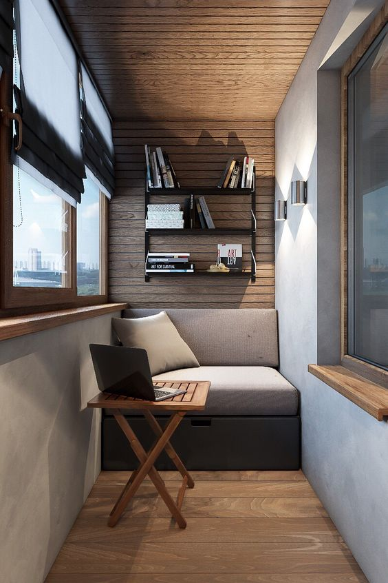 screened balcony for a cozy workspace bench seat with back cushion x base wood table wall mounted bookshelving