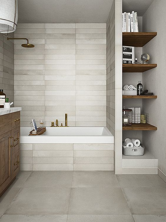 small bathroom with vertical shelving unit bathtub with white tiled walls wooden bathroom vanity