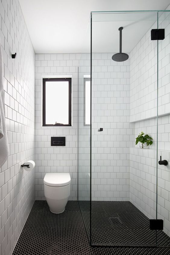 small yet modern bathroom idea white subway tiled walls white toilet mosaic tiled floors in black clear glass door panel walk in shower