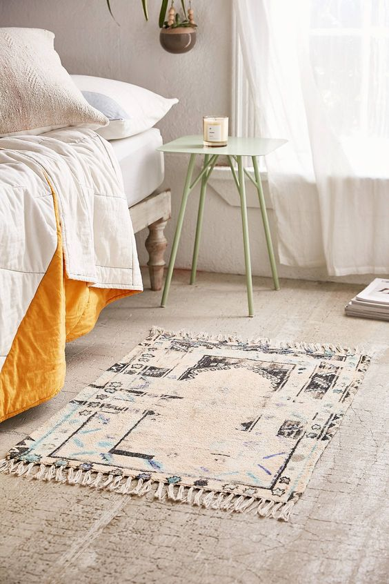 smaller area rug with tassels
