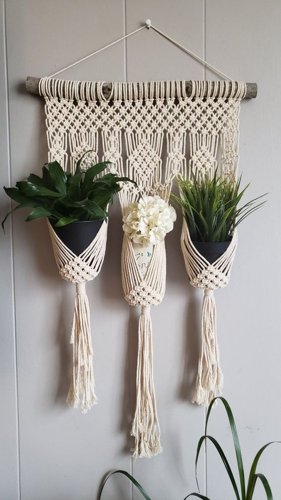 three wall hanging plant holder made of macrame