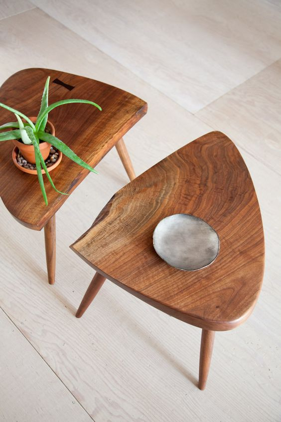 two pieces of triangle shaped coffee table made of wooden in midcentury modern style