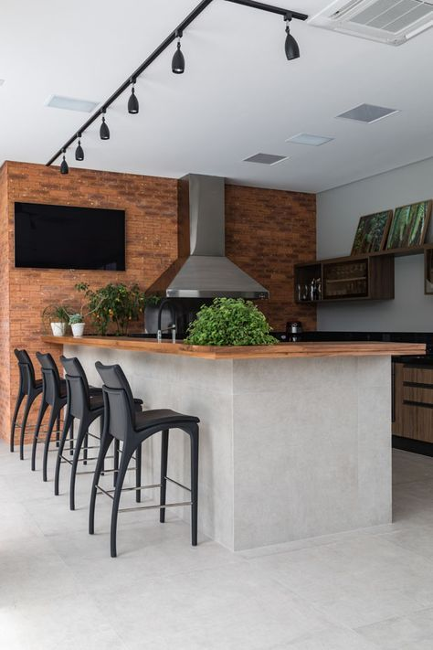 ultra modern kitchen with rustic and industrial touch brick walls hardwood countertop black matte bar stools modern industrial accent light fixture