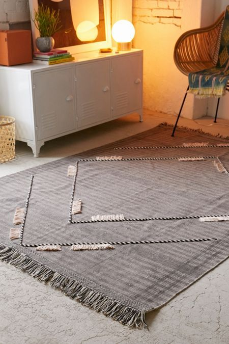 woven tufted area rug in gray with fringed trim addition in both sides