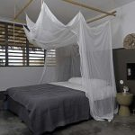 DIY Bed Canopy Made From Bamboos Thin And Semi Transparent Linen In White As The Canopy's Net White Bed Linen Gray Blanket Bare Concrete Floors