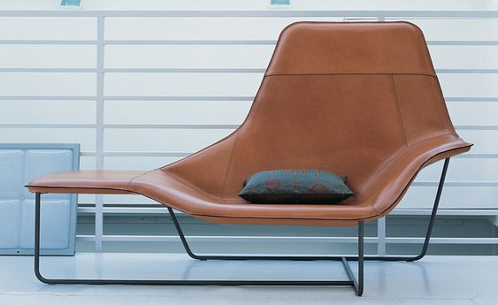 Lama lounge chair with steel frame and leather upholstery