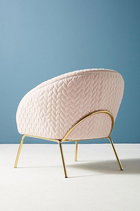 accent chair with blushy pink velvet upholstery and brass legs