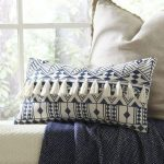 Accent Pillow With Fringes And Bold Geometric Patterns