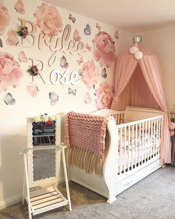 beautiful roses wallpapers pink drapery on bed canopy white baby crib accented with pink throw blanket