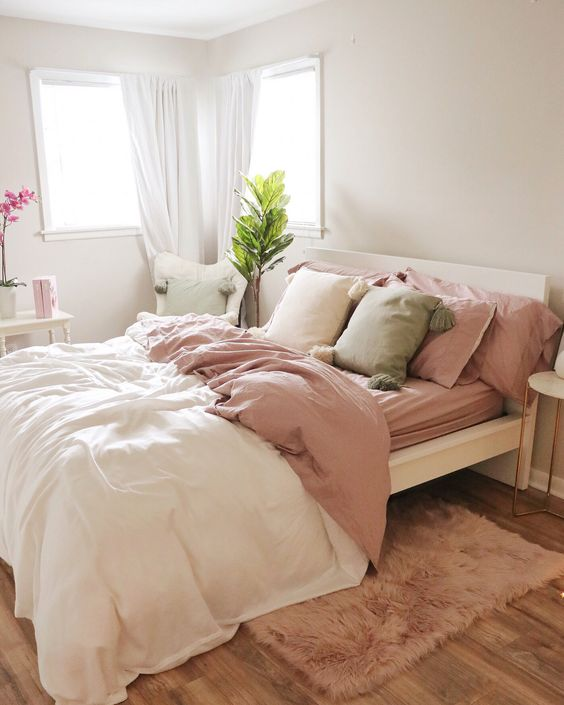 bed line and convertible comforter in rose shade shag rug in rose shade white draperies wooden floors