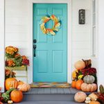 Blue Painted Front Door With Colorful Wreath