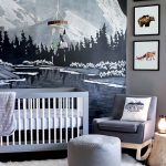 Chalk Drawn Mountain Woodland And River As The Backdrop Gray Nursery Chair With Wood Legs Gray Pouf As Feet Rest Gray Crib White Shag Rug