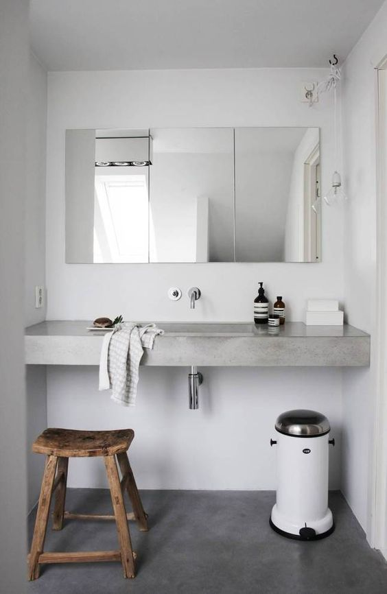 concrete bathroom vanity in soft gray frameless mirror rustic wooden stool
