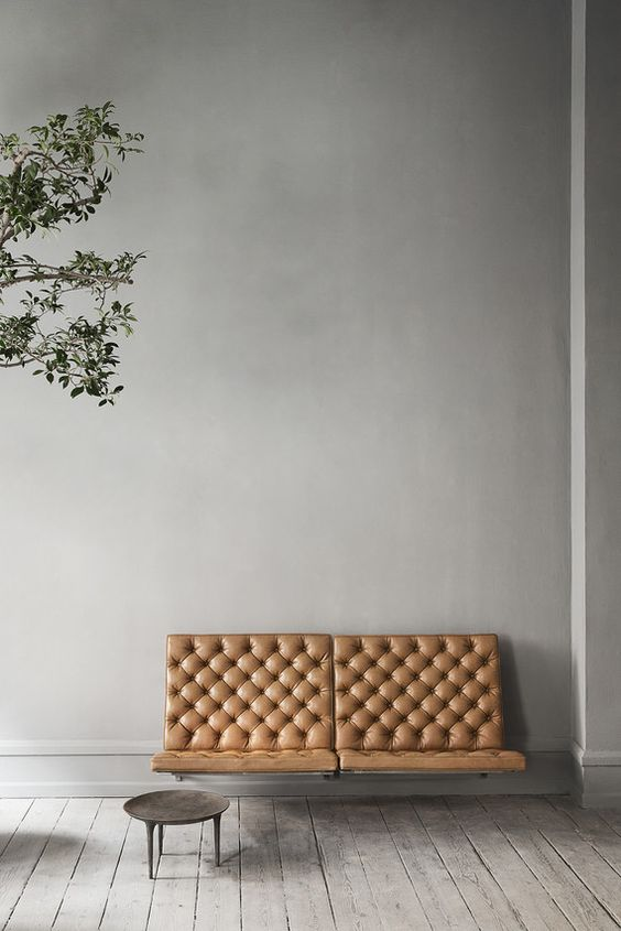contemporary loveseat with tufted leather finish