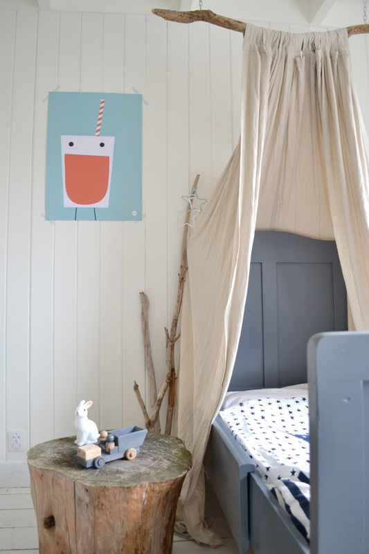 dramatic rustic nursery room with DIY crib canopy made from a big branch worn out linen drapery and log side table
