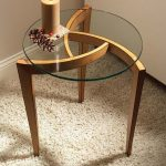 Eyecatching Side Table With Round Glass Top And Unique Wood Frame