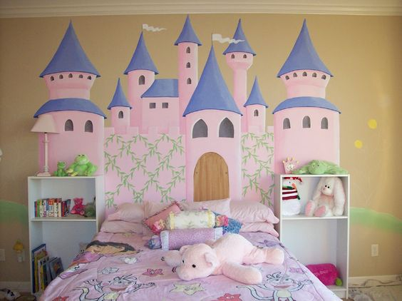 fancy kids' room idea with Walt Disney's castle wall decal a couple of open shelves in white