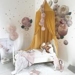 Fancy Kid's Room With Bed Frame Mustard Bed Canopy And Net Flower Print Wallpapers White Shag Rug