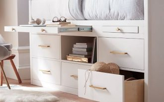 high profile bed frame in white with some pull out drawers and open shelf under the bed