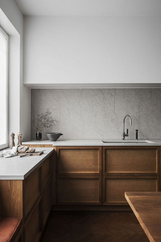 minimalist kitchen design wooden kitchen counter with white countertop crisp white walls white backsplash wooden floors