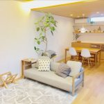 Open Plan Living Room And Dining Room Modern Minimalist Sofa With Wood Frame Folding Magazine Stand Medium Size Houseplant Light Wood Dining Furniture